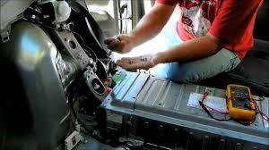 mechanic-technician-repairing-check-engine-light-car